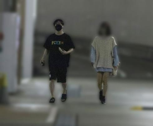 Tatsuhisa and A-ko in the parking lot